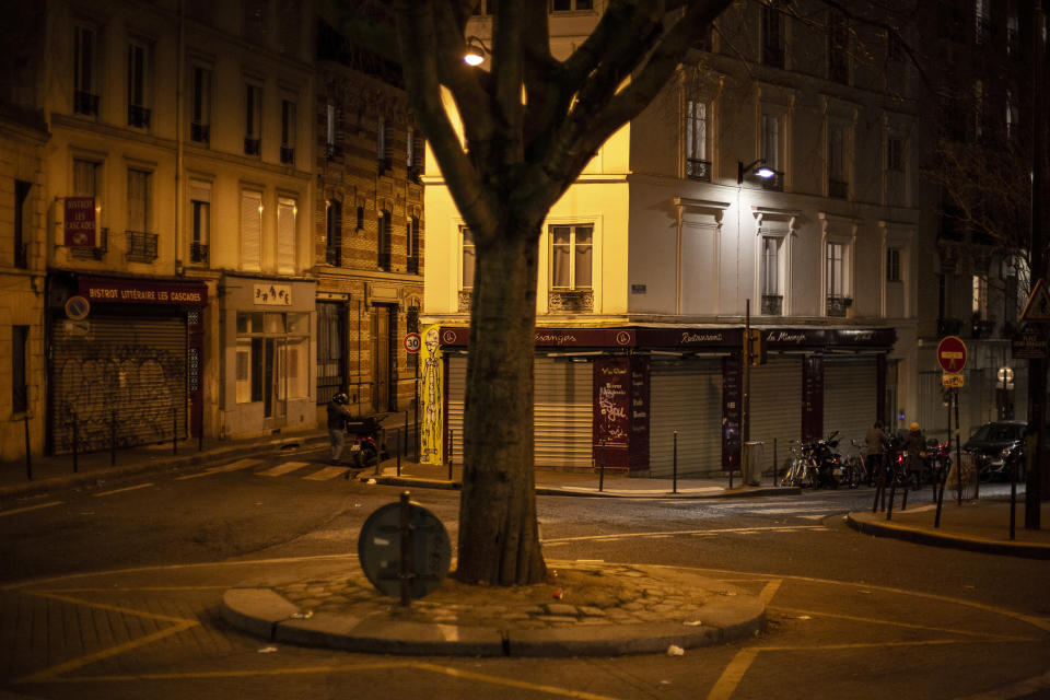 View of an empty street as the 6 p.m curfew starts in Paris, France, Friday, Feb. 26, 2021. The curfew is to cover the whole country, including zones like Paris, where it previously hadn't started until 8 p.m. (AP Photo/Rafael Yaghobzadeh)