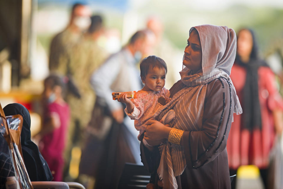Evacuees from Afghanistan arrive after disembarking from a U.S. airforce plane at the Naval Station in Rota, southern Spain, Tuesday Aug. 31, 2021. The United States completed its withdrawal from Afghanistan late Monday, ending America's longest war. (AP Photo/ Marcos Moreno)