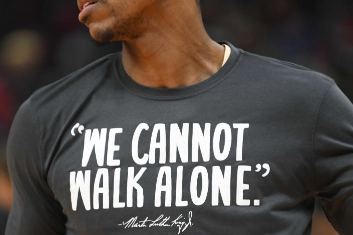 Atlanta Hawks guard Jeff Teague wears a warmup shirt with a quote by Dr. Martin Luther King Jr. before an NBA basketball game against the Toronto Raptors, Monday, Jan. 20, 2020, in Atlanta. (AP Photo/John Amis)