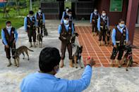 Cambodia's landmine detection authorities are training dogs to sniff out Covid-19 (AFP/TANG CHHIN Sothy)