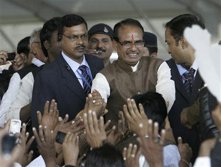 Chouhan, chief minister of Madhya Pradesh, greets his BJP supporters during Chouhan's swearing-in ceremony in the central Indian city of Bhopal