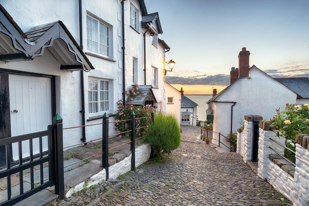 "<p>Clovelly, a stunning harbour village in Devon, tops the rankings for the UK's most Instagrammable village. Known for its flower-strewn cottages that ""tumble"" down a cleft in the cliff to the ancient working port, it's little wonder why.</p>"