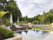 "<p>This hotel that has it all: a sweeping drive, extensive grounds, stables, a spa with an open-air hydrotherapy pool and a Michelin-starred restaurant.</p><p><a href=""https://www.goodhousekeepingholidays.com/offers/wiltshire-colerne-lucknam-park-bridgerton-offer"" rel=""nofollow noopener"" target=""_blank"" data-ylk=""slk:Lucknam Park"" class=""link rapid-noclick-resp"">Lucknam Park</a>'s bedrooms are split between the main house and courtyard, but they all have a country feel, with floral patterns, mahogany details and marble bathrooms.</p><p>Dining in Restaurant Hywel Jones is a real treat. Enjoy a pre-dinner cocktail in the drawing room and a digestif in the library, while leafing through books. The starter of scallops with smoked eel is a dish to order. </p><p>Or, if you're looking for something more low-key, The Brasserie offers relaxed, modern British cuisine.</p><p><a class=""link rapid-noclick-resp"" href=""https://www.goodhousekeepingholidays.com/offers/wiltshire-colerne-lucknam-park-bridgerton-offer"" rel=""nofollow noopener"" target=""_blank"" data-ylk=""slk:EXCLUSIVE DEAL FOR GH READERS"">EXCLUSIVE DEAL FOR GH READERS</a></p>"