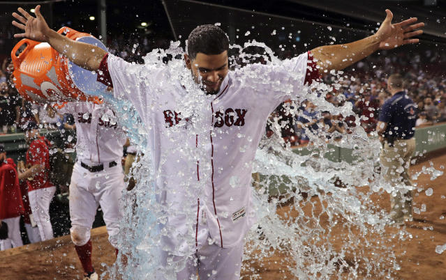 Boston Red Sox's Marco Hernandez is doused after his baseball game-winning bases-loaded single in the bottom of the ninth inning against the Chicago White Sox at Fenway Park in Boston, Monday, June 24, 2019. (AP Photo/Charles Krupa)