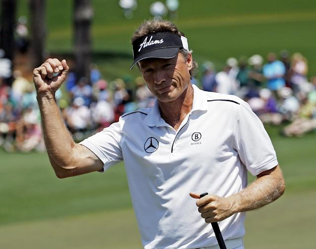 Bernhard Langer, of Germany, holds up his ball after an eagle on the second hole during the fourth round of the Masters golf tournament Sunday, April 13, 2014, in Augusta, Ga. (AP Photo/Matt Slocum)