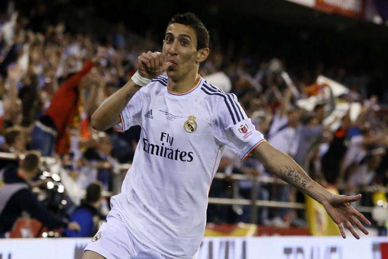 File picture taken on April 16, 2014 shows Argentina midfielder Angel di Maria celebrating after scoring for Real Madrid during the Spanish Copa del Rey final against Barcelona at the Mestalla Stadium in Valencia (AFP Photo/Cesar Manso)