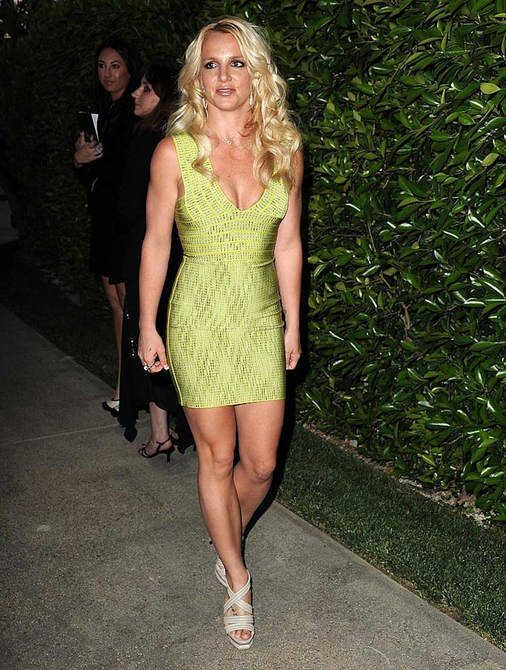 "Britney Spears received a lot of praise the other night when she popped up at the Southern Style soiree in this $1,450 Herve Leger by Max Azria bandage dress, strappy sandals, and fluffy hair extensions. I, on the other hand, think she looks extremely outdated. Discuss. Steve Granitz/<a href=""http://www.wireimage.com"" target=""new"">WireImage.com</a> - May 11, 2011"