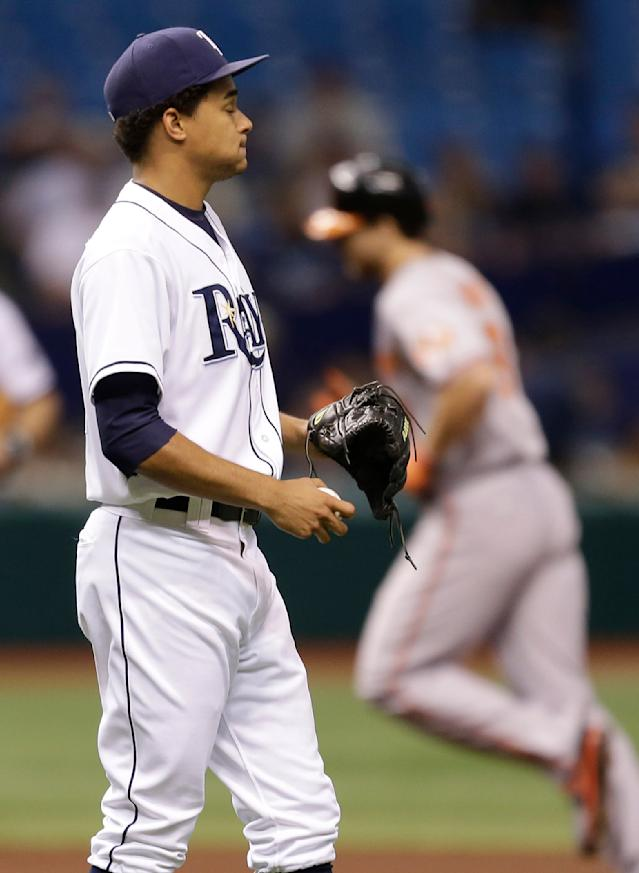 Tampa Bay Rays starting pitcher Chris Archer, left, waits as Baltimore Orioles' Chris Davis rounds the bases after hitting a fourth-inning, two-run home during a baseball game Monday, Sept. 23, 2013, in St. Petersburg, Fla. (AP Photo/Chris O'Meara)