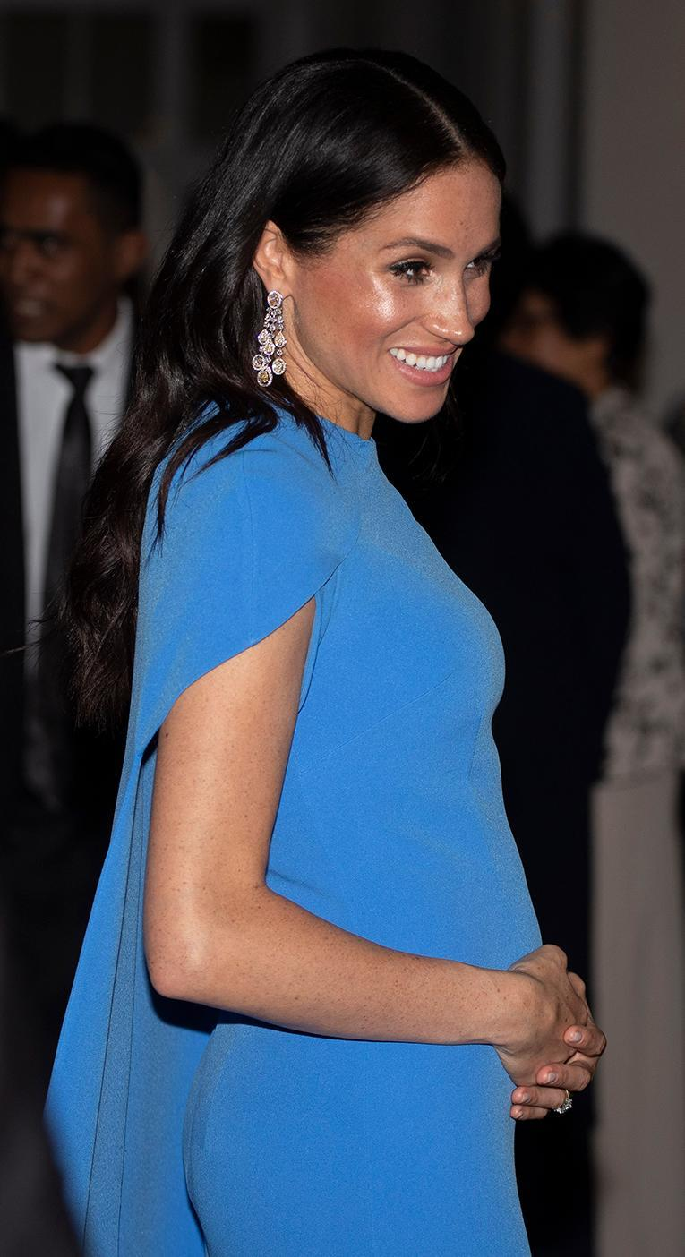 There's a reason the Duchess has been pictured touching her bump [Photo: Getty]