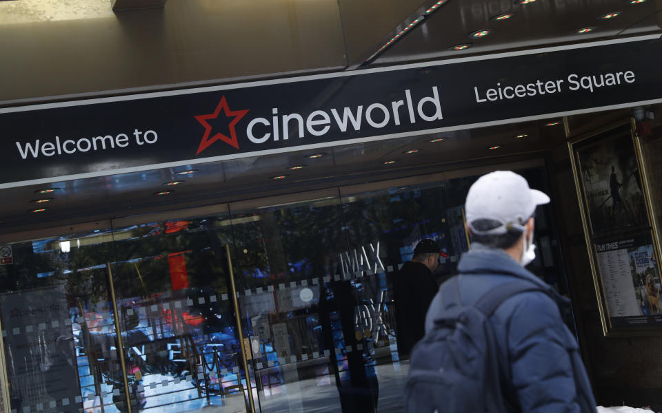 A man walks past a Cineworld cinema in Leicester Square, London, Monday, Oct. 5, 2020. The company Cineworld have confirmed that all the 127 UK cineworld cinemas will temporarily close, affecting some 5,500 employees, this is due to the ongoing coronavirus pandemic and the lack of movies at are being released. (AP Photo/Alastair Grant)