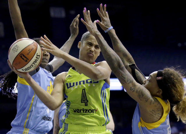 FILE - In this Wednesday, Aug. 30, 2017, file photo, Dallas Wings guard Skylar Diggins-Smith, center, looks to pass against Chicago Sky forward Jessica Breland, left, and guard Cappie Pondexter during the second half of a WNBA basketball game in Rosemont, Ill. Diggins-Smith wants to find a new team to play for in the 2020 WNBA season. (AP Photo/Nam Y. Huh, File)
