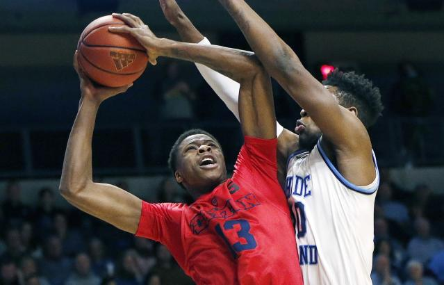 "Dayton's Kostas Antetokounmpo (13) goes up to shoot against Rhode Island's <a class=""link rapid-noclick-resp"" href=""/ncaab/players/136736/"" data-ylk=""slk:Cyril Langevine"">Cyril Langevine</a> (10) during the first half of an NCAA college basketball game in South Kingstown, R.I., Friday, Feb. 23, 2018. (AP Photo/Michael Dwyer)"