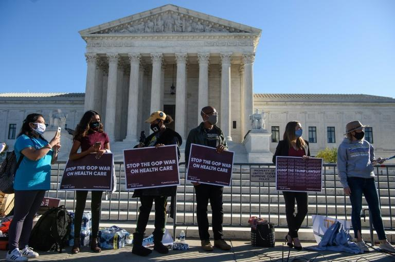 Supporters of the Affordable Care Act in front of the US Supreme Court ahead of a hearing on the constitutionality of the popular health insurance program