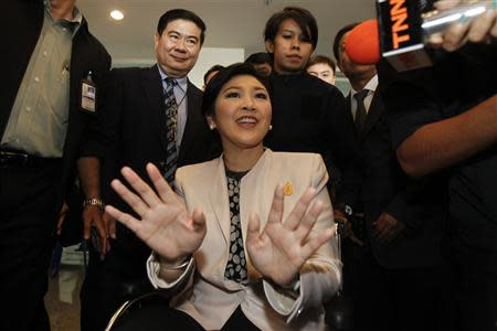 Thai Prime Minister Yingluck Shinawatra leaves the National Anti-Corruption Commission office in Nonthaburi province, on the outskirts of Bangkok