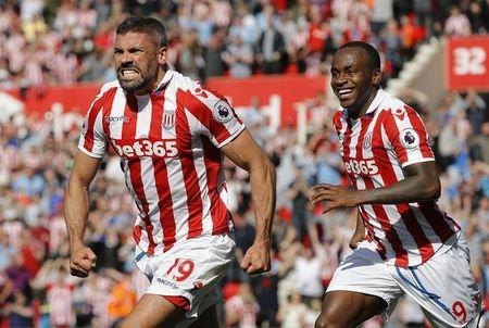 Britain Football Soccer - Stoke City v Liverpool - Premier League - bet365 Stadium - 8/4/17 Stoke City's Jonathan Walters celebrates scoring their first goal with Saido Berahino Reuters / Darren Staples Livepic