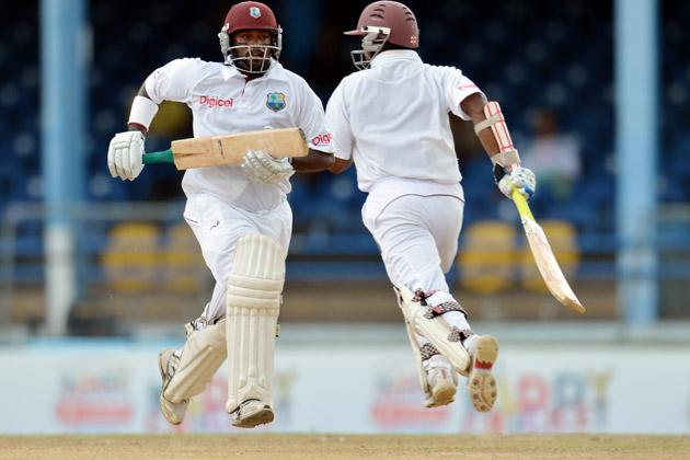 West Indies batsman Narsingh Deonarine (L) and teammate Shivnarine Chanderpaul (R) run during the third day of the second-of-three Test matches between Australia and West Indies April 17, 2012 at Queen's Park Oval in Port of Spain, Trinidad. AFP PHOTO/Stan HONDA (Photo credit should read STAN HONDA/AFP/Getty Images)