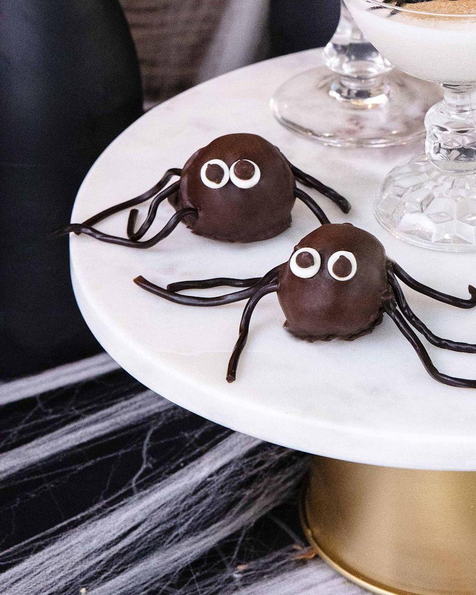 """<p>Chocolate sandwich cookies mixed with cream cheese and then dipped in chocolate? Scary-good.</p><p><em><a href=""""https://www.countryliving.com/food-drinks/a33943269/spider-cookie-truffles/"""" rel=""""nofollow noopener"""" target=""""_blank"""" data-ylk=""""slk:Get the recipe from Country Living »"""" class=""""link rapid-noclick-resp"""">Get the recipe from Country Living »</a></em></p>"""