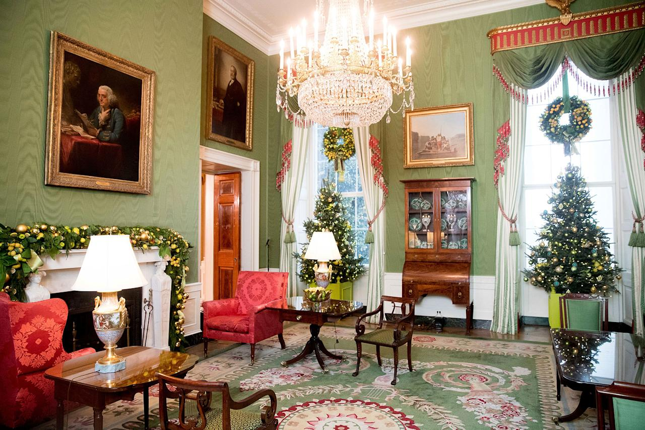 the green room is decorated at the white house during a preview of