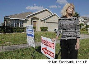 Realtor at a foreclosed home sale, looking worried