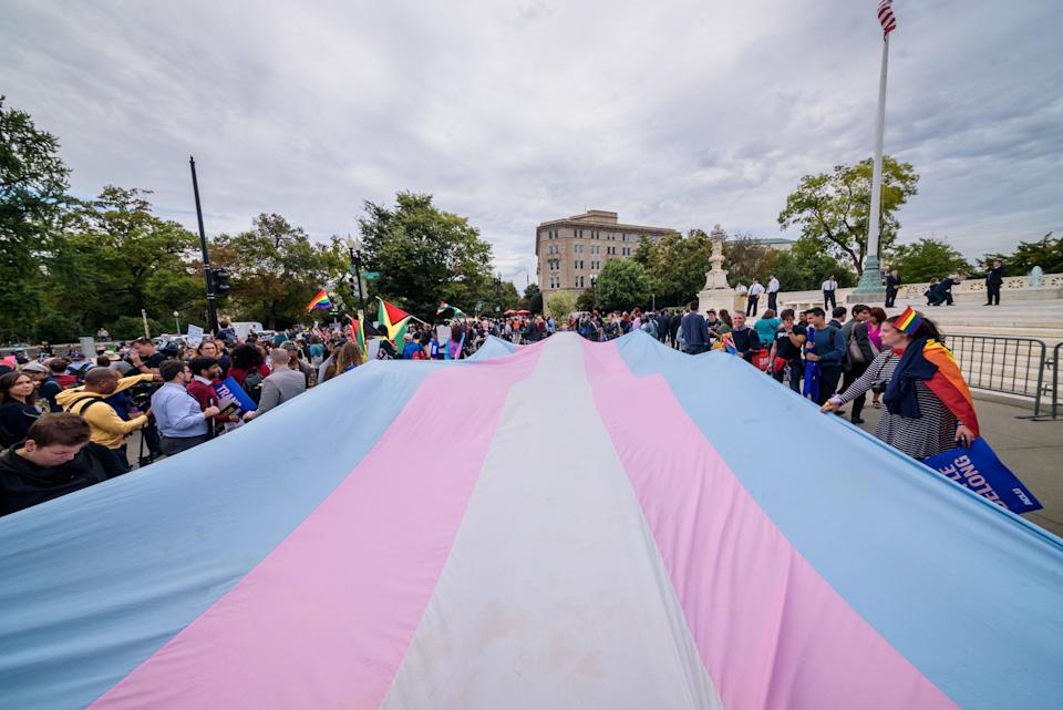 Demonstrators unfurl a giant Trans Pride flag outside the U.S. Supreme Court in 2019. (Photo: Erik McGregor via Getty Images)