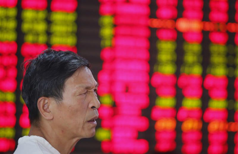 An investor looks at the stock price monitor at a private securities company in Shanghai, China, Monday, Aug. 5, 2013. Asian stock markets sagged Monday after a disappointing U.S. jobs report sparked worries about the health of the world's biggest economy. (AP Photo)