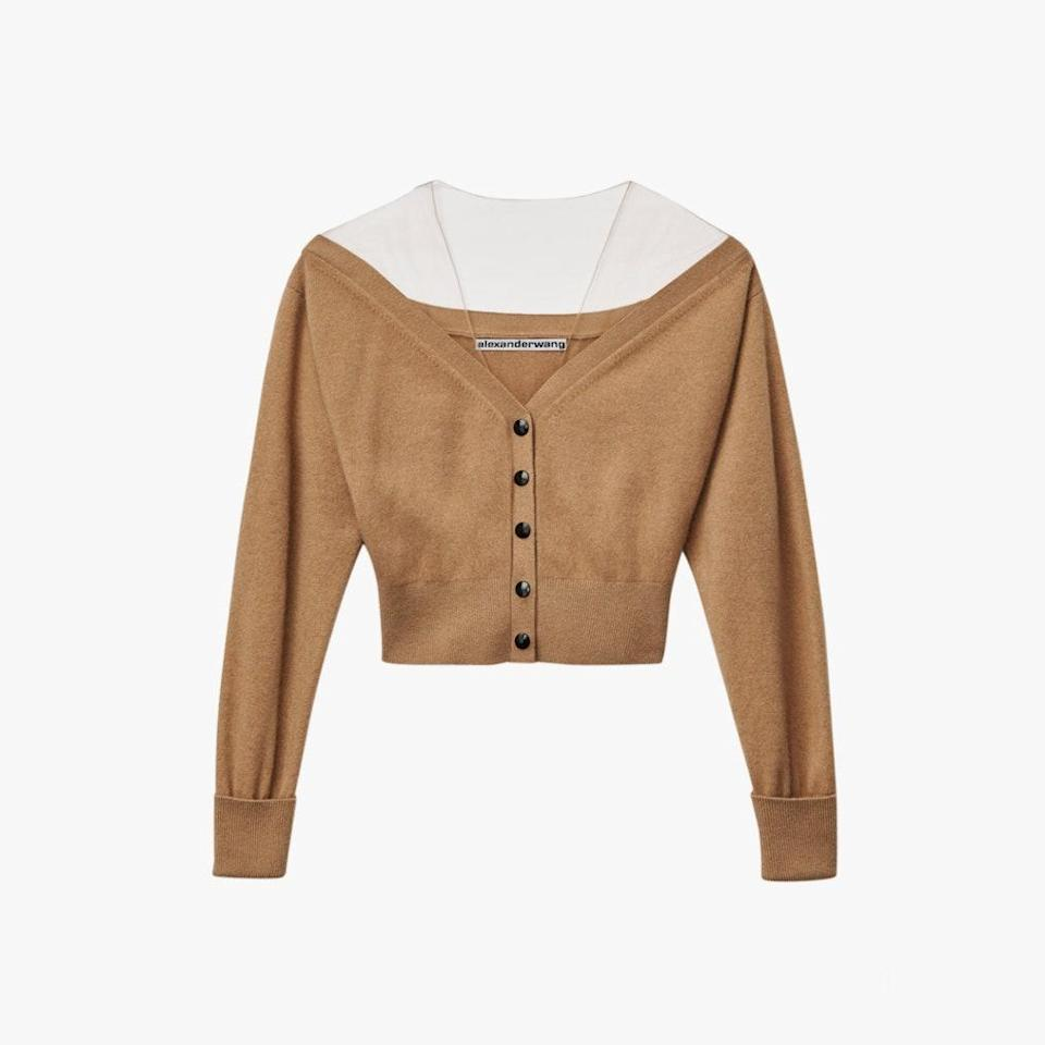 """Get the off-the-shoulder effect (without the constant readjustments) with a cardigan that has a mesh panel, like this one. $550, THE WEBSTER. <a href=""""https://thewebster.us/shop/wool-off-the-shoulder-cardigan-neutral.html"""" rel=""""nofollow noopener"""" target=""""_blank"""" data-ylk=""""slk:Get it now!"""" class=""""link rapid-noclick-resp"""">Get it now!</a>"""