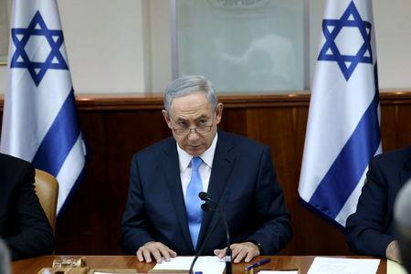 Israeli Prime Minister Benjamin Netanyahu opens the weekly cabinet meeting at his Jerusalem office moments after he was informed about a shooting attack in Jerusalem