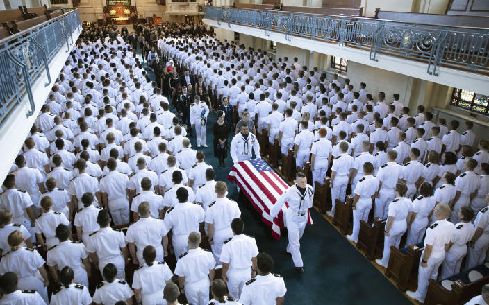 In this image proved by the family of John McCain, the family follows as the casket of Sen. John McCain, R-Ariz., is moved from the Chapel on the grounds of the United States Naval Academy after a service Sunday, Sept. 2, 2018, in Annapolis, Md. The casket was carried by horse-drawn caisson to the cemetery at the Naval Academy where McCain was buried. (David Hume Kennerly/McCain Family via AP)