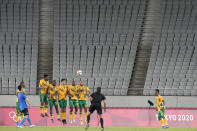 FILE - In this July 22, 2021, file photo, Japan's Maya Yoshida, left, takes a penalty kick against South Africa as the stands sit empty during a men's soccer match at the 2020 Summer Olympics in Tokyo, Japan. In arenas across Tokyo, athletes accustomed to feeding off the deafening roar of the crowd are searching for new ways to feel Olympic enthusiasm. (AP Photo/Shuji Kajiyama, File)