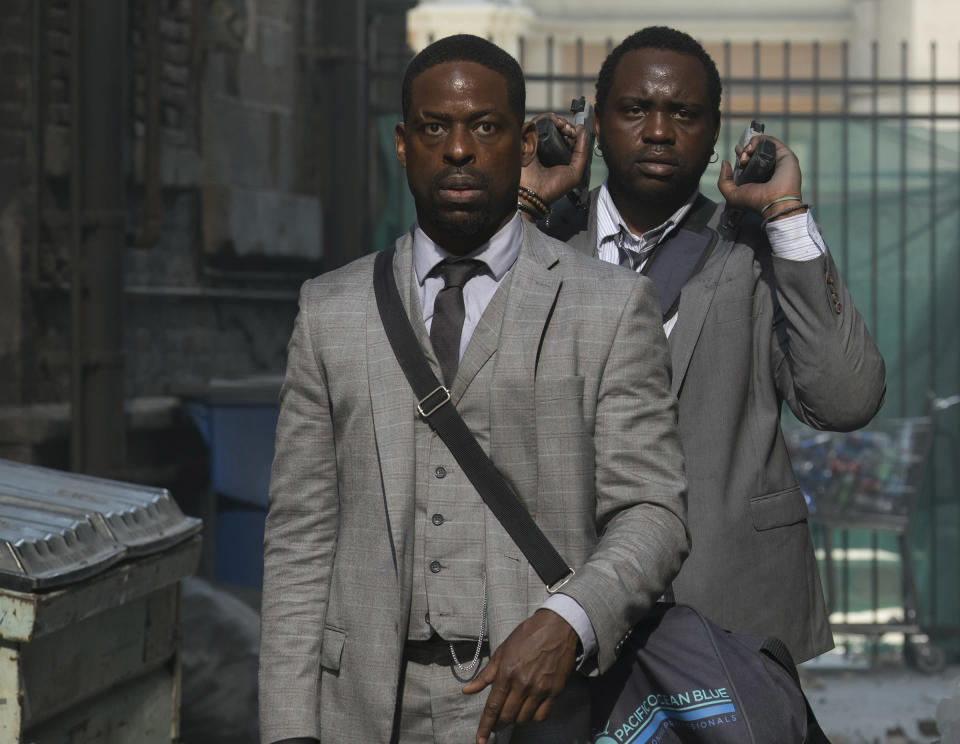 Sterling K. Brown and Brian Tyree Henry star as two bank-robbing brothers who have to check into the <i>Hotel Artemis</i> after a heist gone wrong. (Photo: Global Road Entertainment)