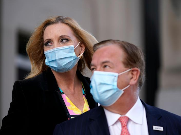 Mark and Patricia McCloskey leave following a court hearing on Wednesday 14 October 2020, in St. Louis ((Associated Press))