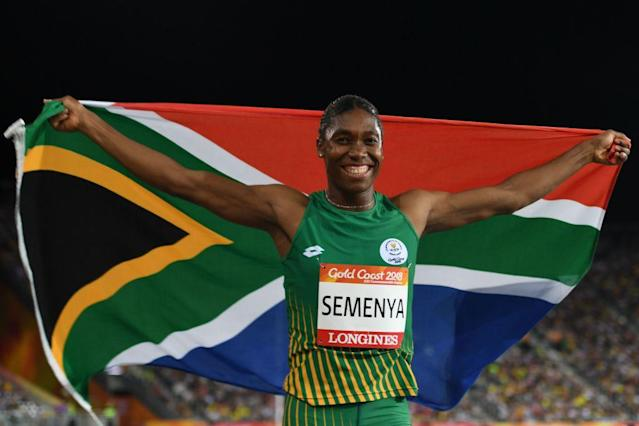 South Africa's Caster Semenya celebrates with flag after winning the women's 800-meter final during the 2018 Gold Coast Commonwealth Games on April 13. Critics of a new IAAF rule about female levels of testosterone say Semenya is the undeserving target. (Photo: Saeed Khan/AFP/Getty Images)