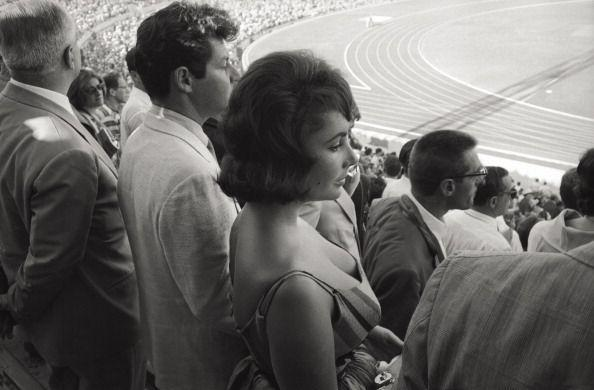 <p>VIPs are always in attendance at Olympics opening ceremonies. But as the world entered the tabloid era, glamorous spectators could often steal the spotlight from the athletes. In 1960, Elizabeth Taylor and her fourth husband, Eddie Fisher, were photographed from the stands of the Olympics arena during the opening ceremony for the Summer Games in Rome.</p>