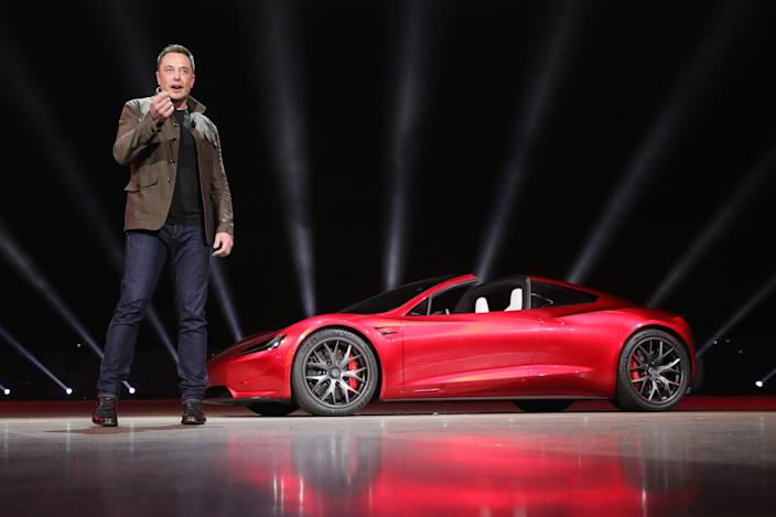 Tesla CEO Elon Musk and the new Roadster.