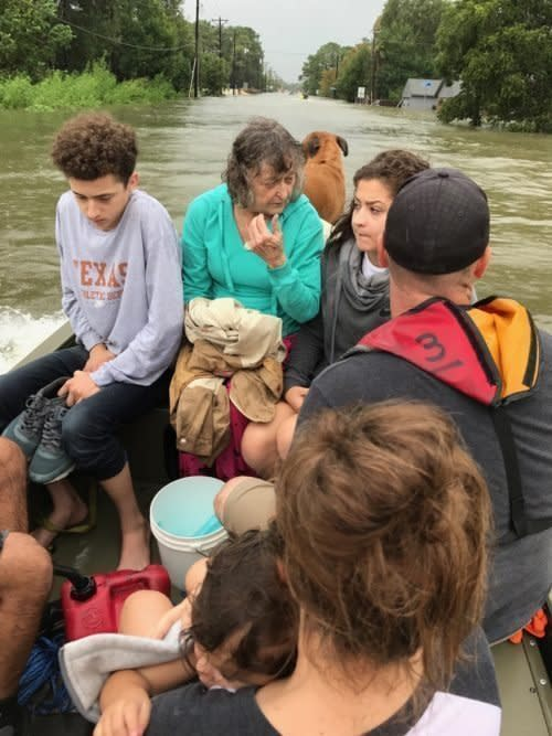 Tim Miller's granddaughter Natalie (front right), with other members of her family boating to safety in the aftermath of Harvey. (TIM MILLER/TEXAS EQUUSEARCH)