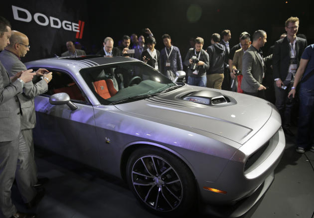 Endangered. Car buffs love the Dodge Challenger, but it could end up orphaned if GM ever merges with Fiat Chrysler. Photo by AP Photo/Seth Wenig.