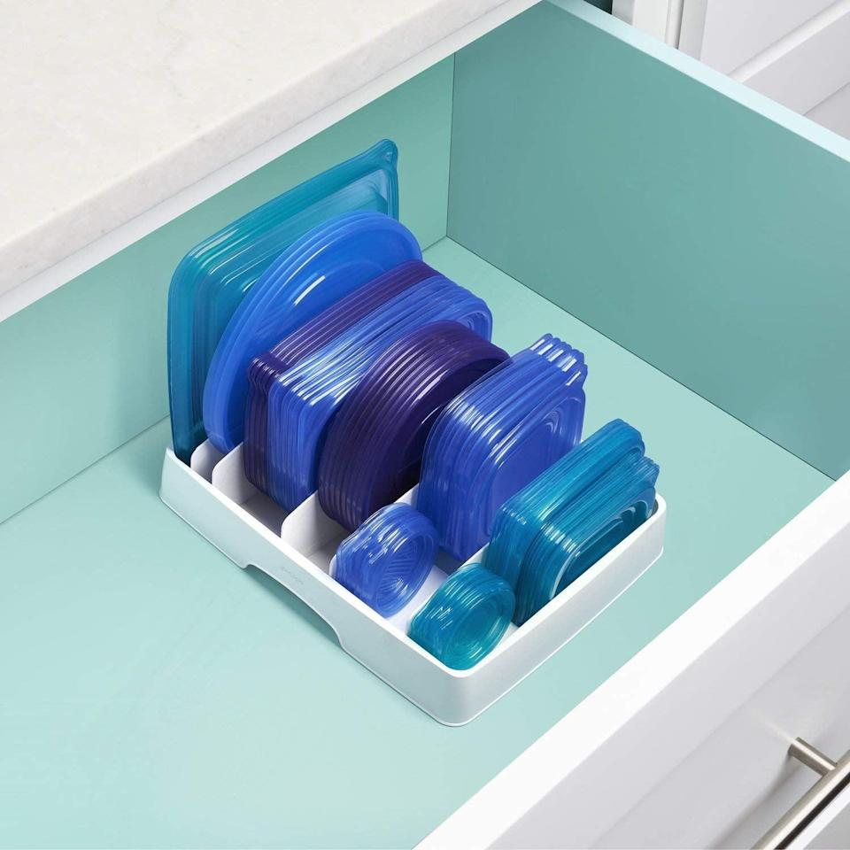 <p>If your cabinet is always overflowing with container lids, get this <span>YouCopia StoraLid Food Container Lid Organizer</span> ($16-$23) to keep it all together. It comes in a few different sizes, so you can find the right one for your cabinets. </p>