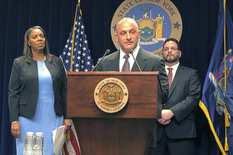 Justin Sangeorge, a social worker and recovering opioid addict, speaks at a news conference, Thursday, March 28, 2019, about a New York state lawsuit against opioid drug manufacturers and distributors. Behind him are New York Attorney General Letitia James, left, and drug abuse treatment center director Gary Butchen. New York on Thursday sued the billionaire family behind OxyContin, joining a growing list of state and local governments alleging the drugmaker sparked the nation's opioid crisis by putting hunger for profits over patient safety. (AP Photo/Jennifer Peltz)