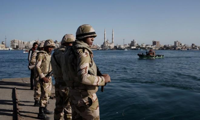 Egyptian soldiers guard the Suez Canal after the announcement of the final verdict in the case of the Port Said football massacre.
