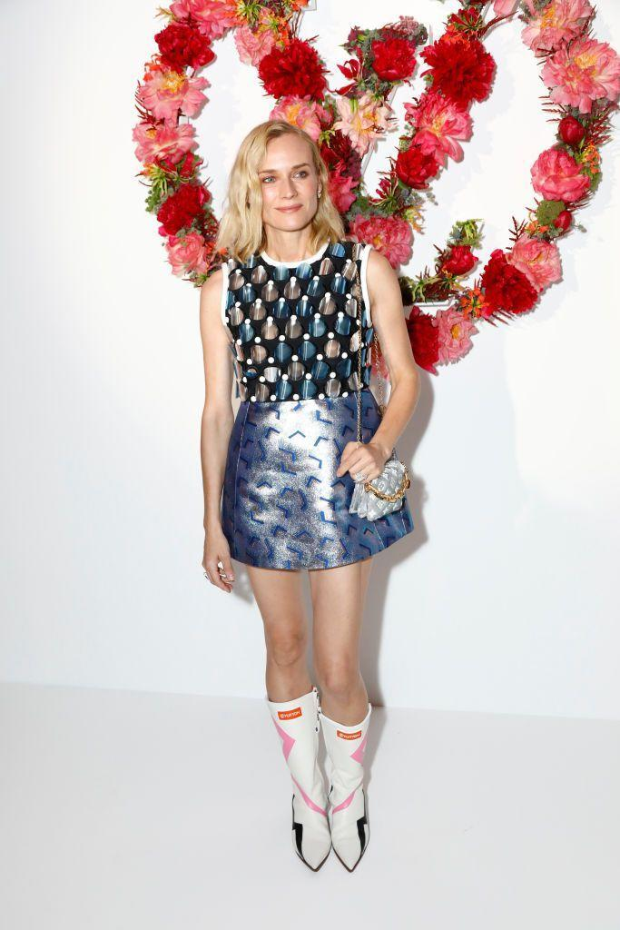<p>The actor wore a mini dress and white boots for the dinner. </p>