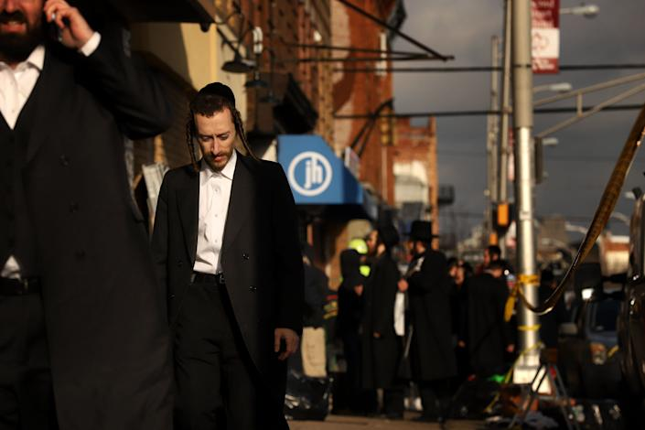 Members of the Jewish community gather around the JC Kosher Supermarket on Wednesday. (Photo: Rick Loomis via Getty Images)