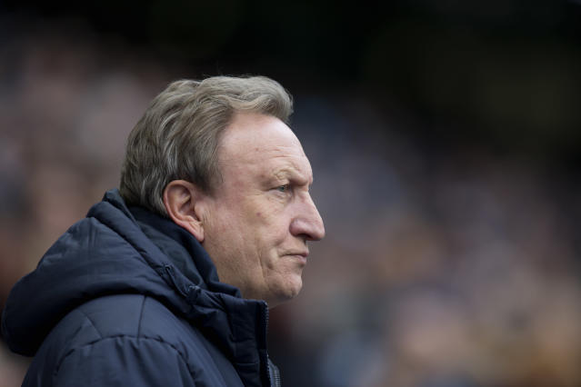FILE - In this file photo dated Saturday Dec. 20, 2014, Crystal Palace's manager Neil Warnock takes to the touchline before his team's English Premier League soccer match against Manchester City at the Etihad Stadium in Manchester, England. The charismatic Neil Warnock now manages Cardiff soccer club who have gained English Premier League status for the 2018 - 19 season, promoted against the odds last season with a mostly unheralded group of players bought on the cheap. (AP Photo/Jon Super, FILE)