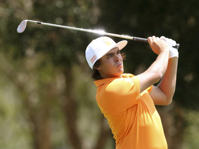 Rickie Fowler of the United States plays a shot during the final round of the Australian PGA golf championship held at the Royal Pines Resort, on the Gold Coast, in Australia, Sunday, Nov. 10, 2013. (AP Photo/Tertius Pickard)