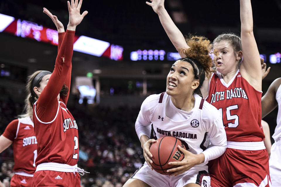 South Carolina guard Breanna Beal battles in the paint against South Dakota forward Taylor Frederick (15) and Liv Korngable (2) during the first half of an NCAA college basketball game Sunday, Dec. 22, 2019, in Columbia, S.C. (AP Photo/Sean Rayford)