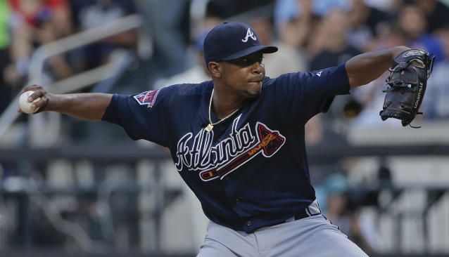 Atlanta Braves pitcher Julio Teheran (49) delivers against the New York Mets during the first inning of a baseball game, Tuesday, July 8, 2014, in New York. (AP Photo/Julie Jacobson)