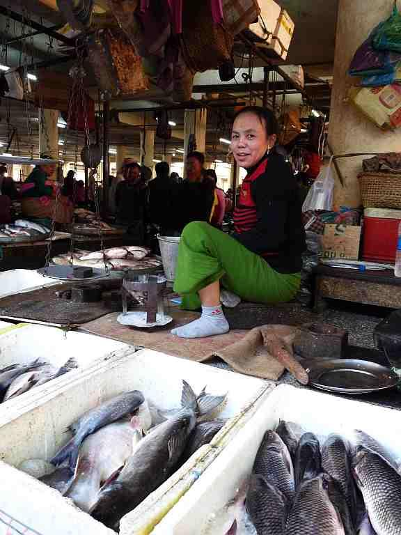 This cheerful Ima at the fish-market smiles for the camera.