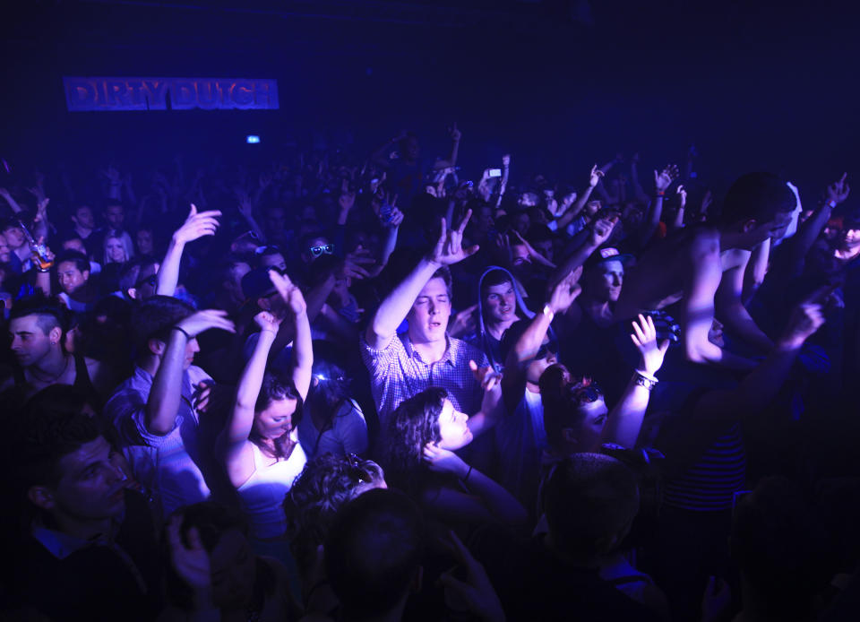 Clubbers dance at the Ministry of Sound nightclub in south London April 29, 2012. REUTERS/Olivia Harris (BRITAIN - Tags: ENTERTAINMENT SOCIETY)