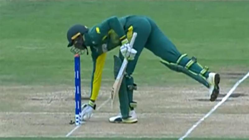 Pillay makes the mistake of picking up the ball. Pic: ICC