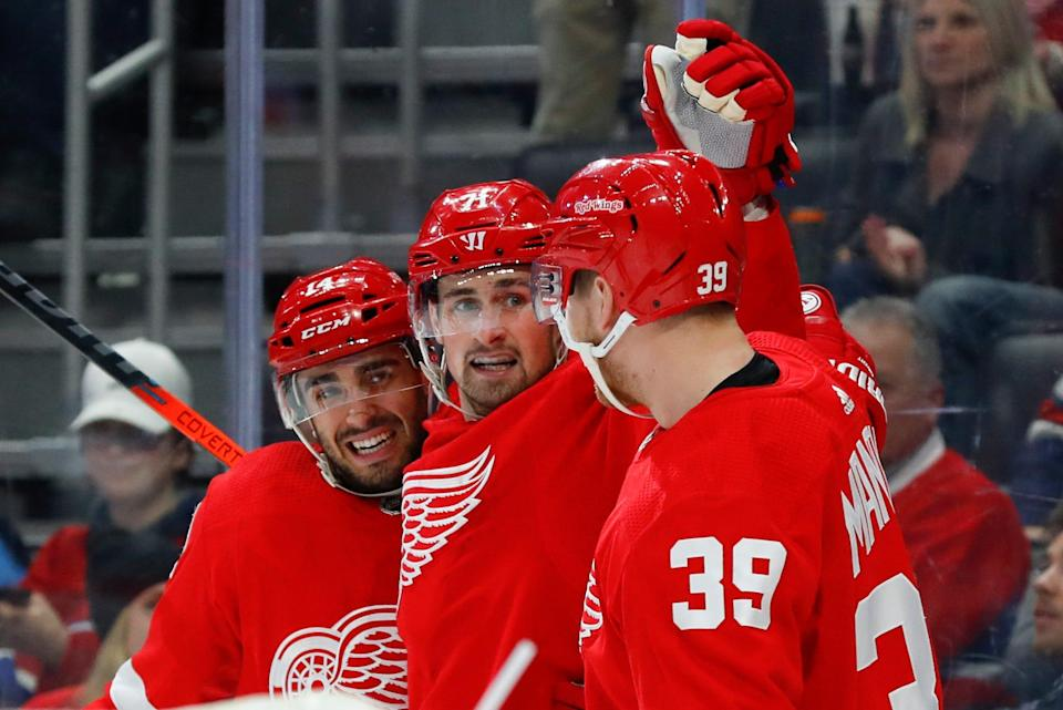It's coming up on nine months since the Red Wings last played. Here they are celebrating a goal from Robby Fabbri (left) in a vctory over Montreal on Tuesday, Feb. 18, 2020, in Detroit. (AP Photo/Paul Sancya).