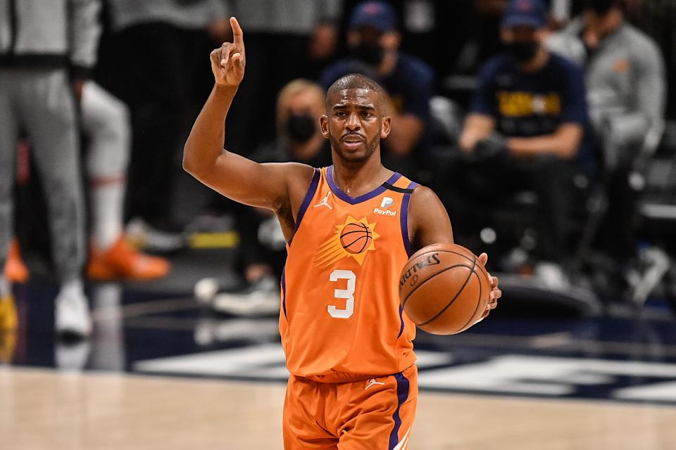 Chris Paul #3 of the Phoenix Suns directs the offense in the first half in Game Three of the Western Conference second-round playoff series at Ball Arena on June 11, 2021 in Denver, Colorado. NOTE TO USER: User expressly acknowledges and agrees that, by downloading and or using this photograph, User is consenting to the terms and conditions of the Getty Images License Agreement. (Photo by Dustin Bradford/Getty Images)